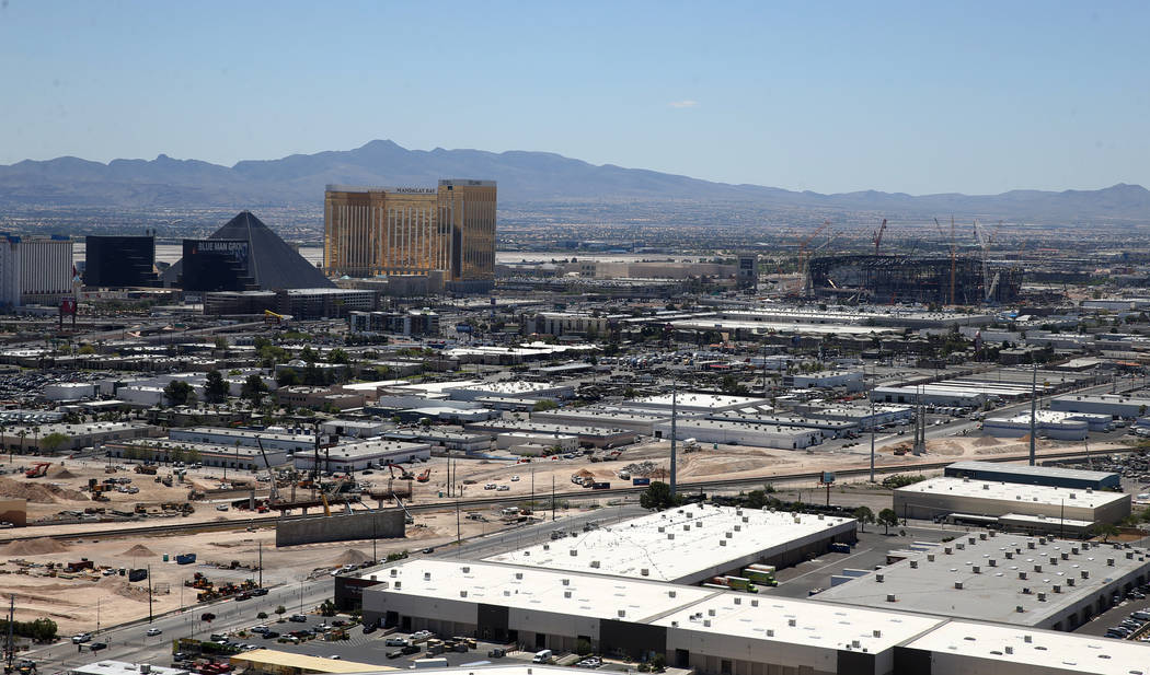 The Raiders Stadium under construction during an announcement for the Mitsubishi Las Vegas Bowl ...