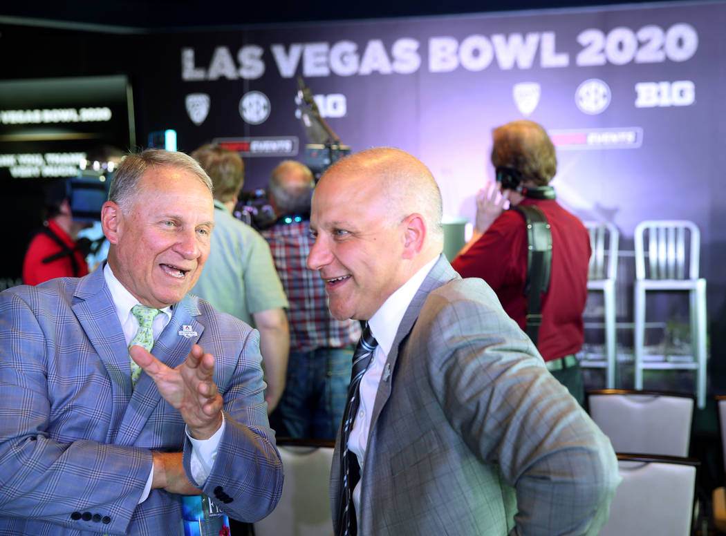 Pete Derzis of ESPN Events, left, and Raiders President Marc Badain, during announcement for th ...