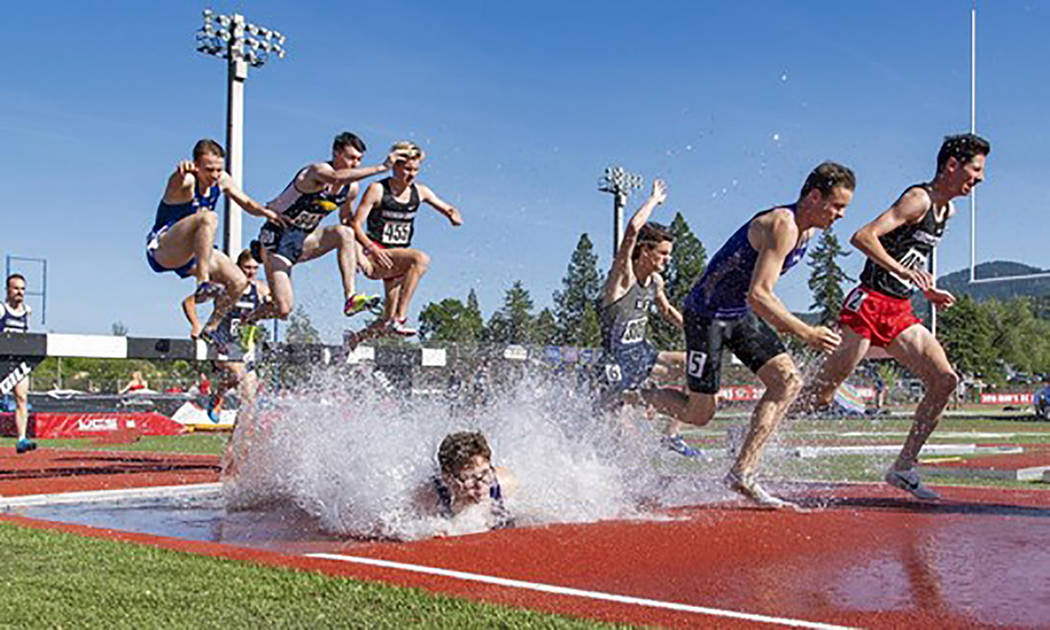 Special to the Pahrump Valley Times College of Idaho's Bryce Odegard, second from right, handle ...