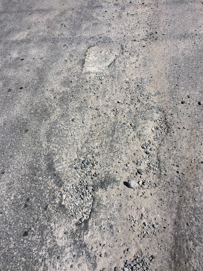 Robin Hebrock/Pahrump Valley Times These potholes at the intersection of Turner Boulevard and Q ...