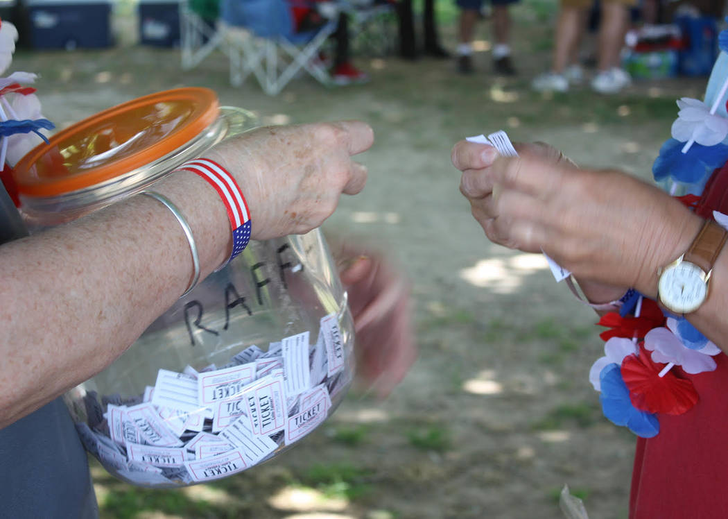 Robin Hebrock/Pahrump Valley Times Raffle tickets were loaded into a plastic jar in preparation ...