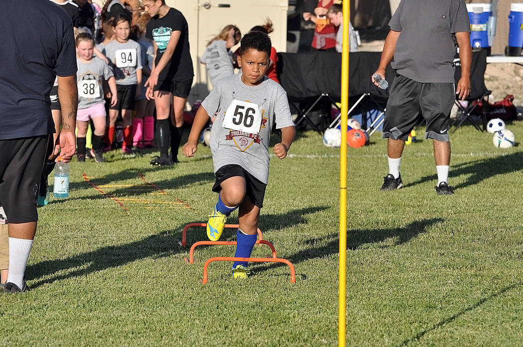 Horace Langford Jr./Pahrump Valley Times A determined young player runs a drill during the Juni ...