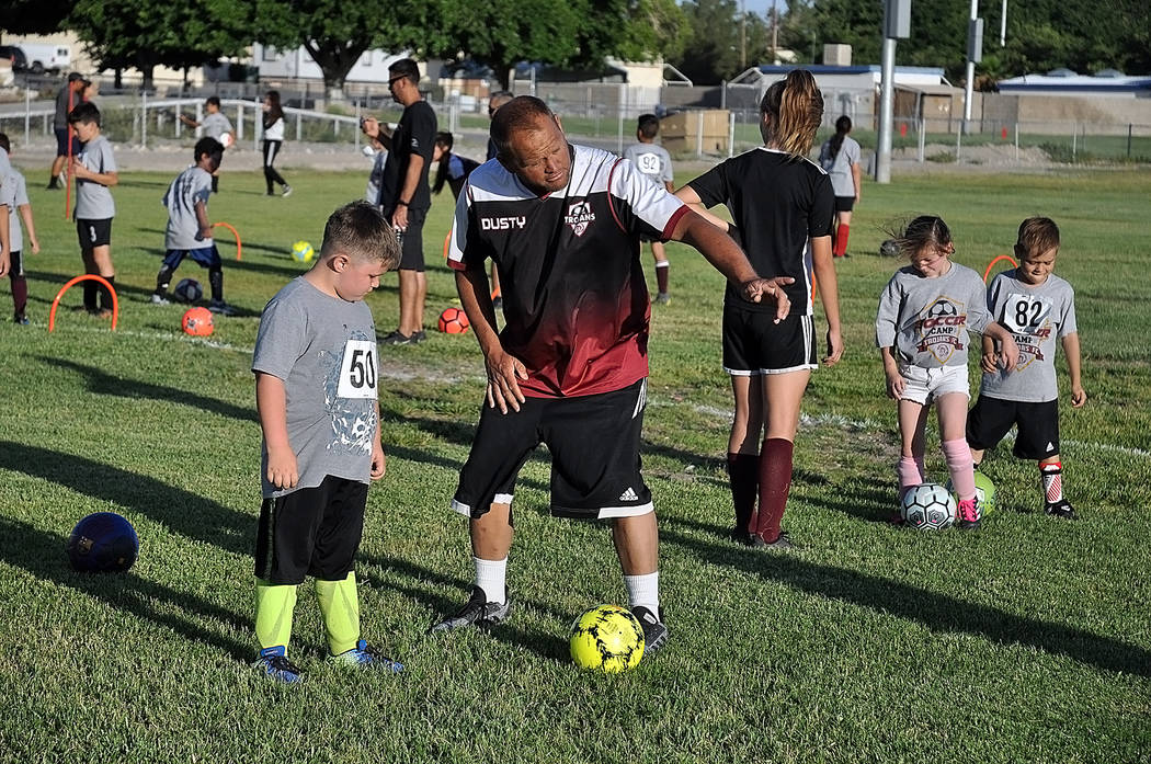 Horace Langford Jr./Pahrump Valley Times Dusty Park gives a prospective soccer player instructi ...