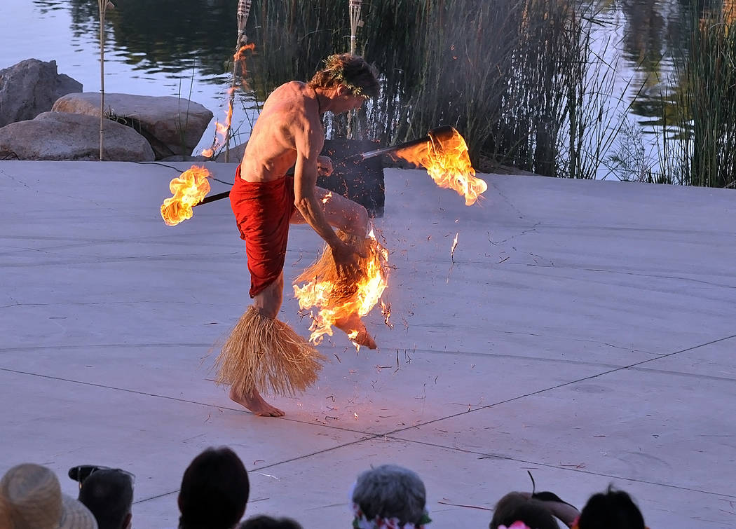 Horace Langford Jr./Pahrump Valley Times The fire fire dancer aware that his leg had caught fi ...