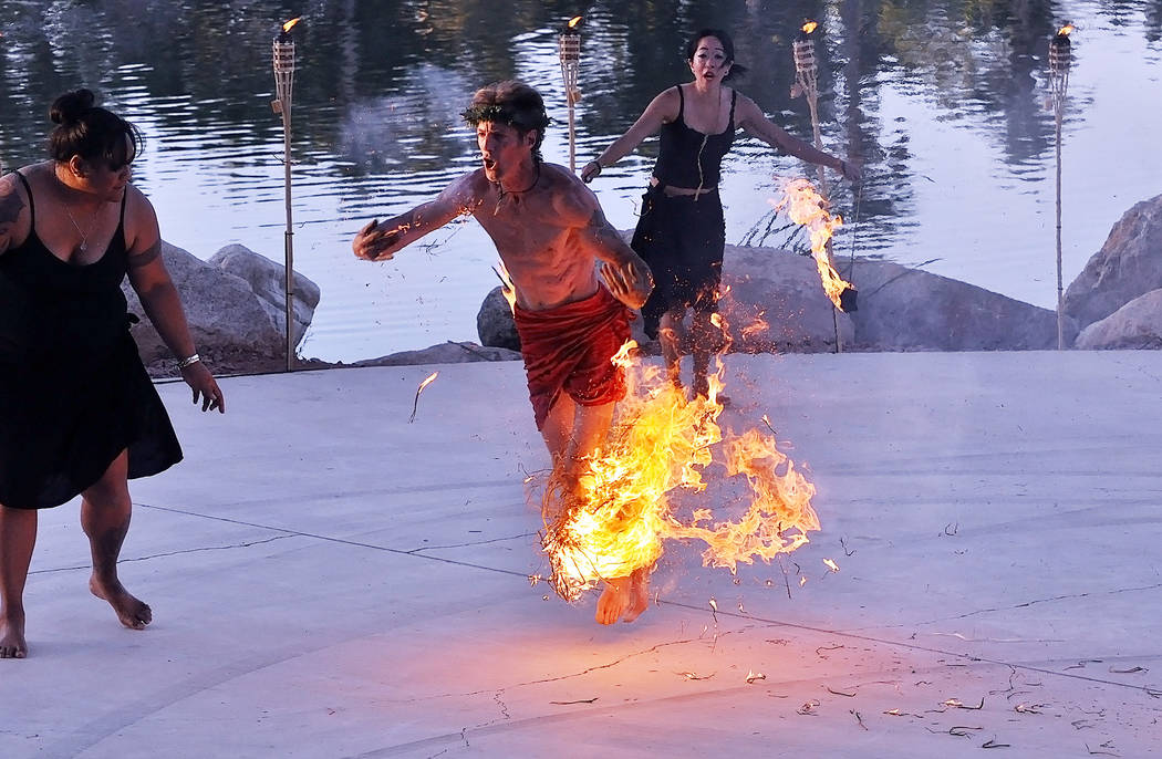 Horace Langford Jr./Pahrump Valley Times A fire dancer with his leg on fire at a luau in Pahru ...