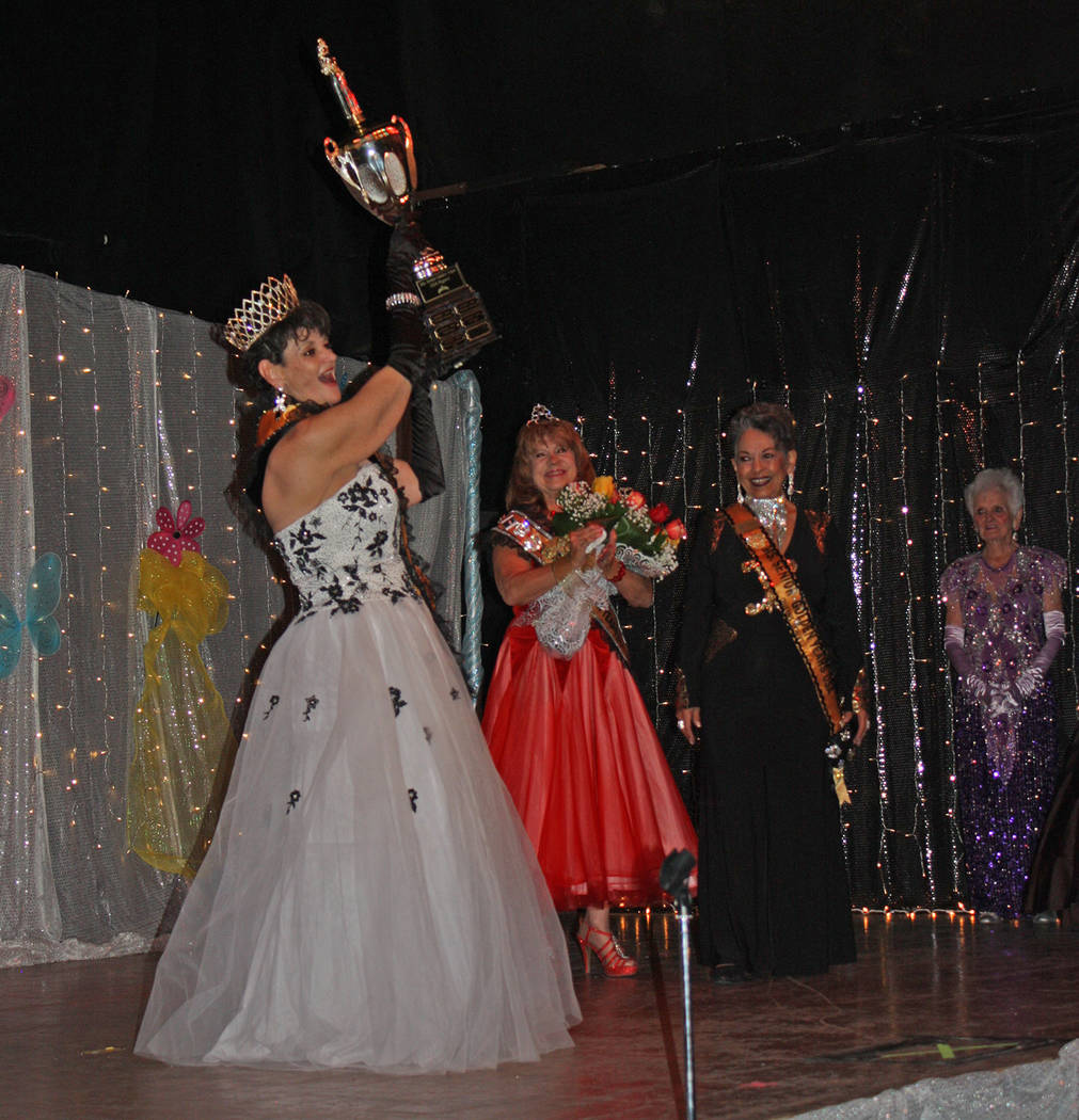 Robin Hebrock/Pahrump Valley Times Laraine Babbitt holds her trophy on high while the audience, ...