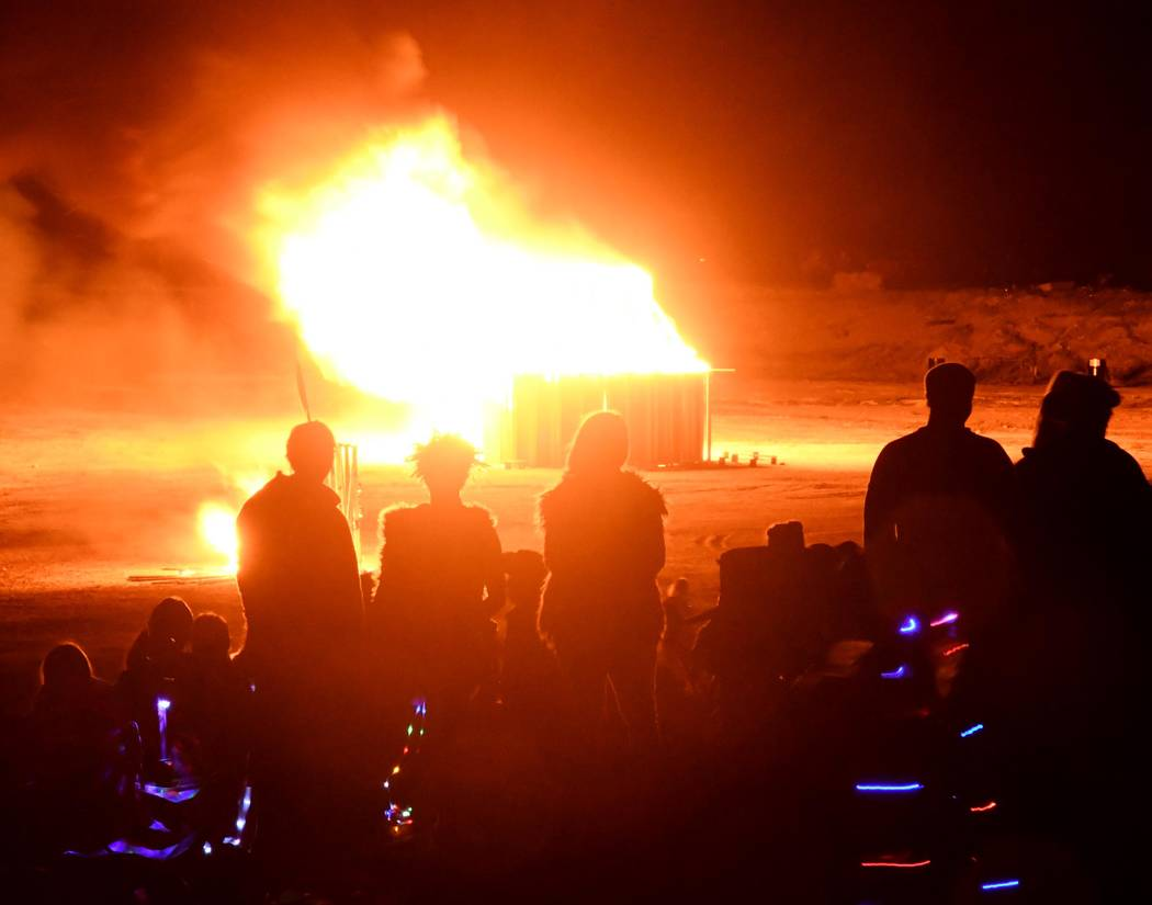 Richard Stephens/Special to the Pahrump Valley Times Burning Man attendees watch burning of str ...
