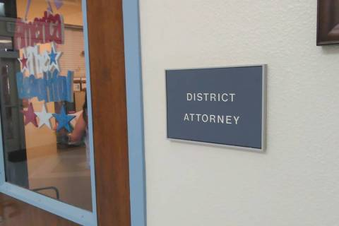 Selwyn Harris/Pahrump Valley Times A sign outside the Nye County District Attorney's Office in ...
