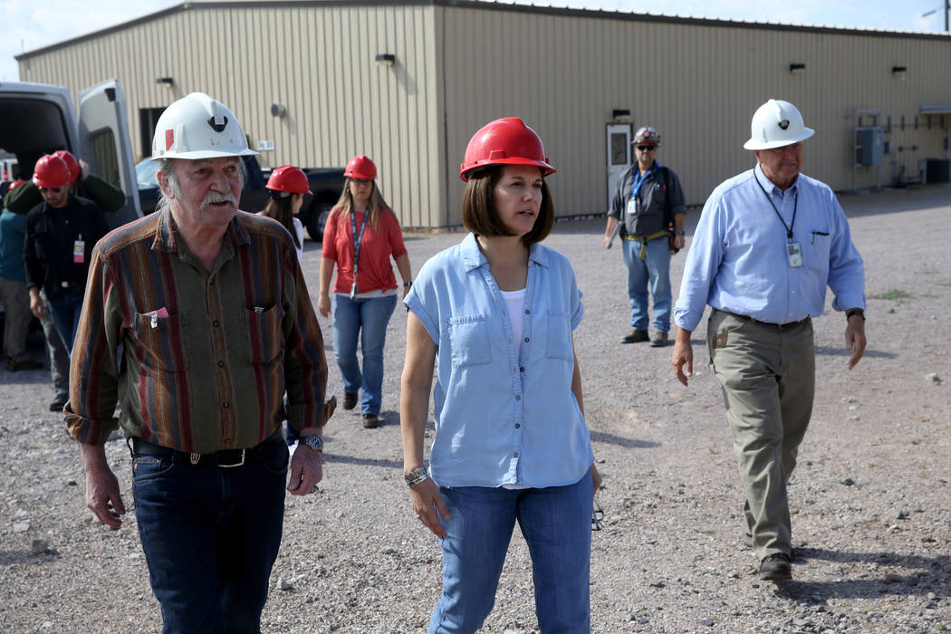 U.S. Sen. Catherine Cortez Masto, D-Nev., walks with Steve Frishman, a technical consultant to ...