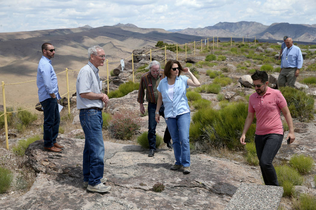 U.S. Sen. Catherine Cortez Masto, D-Nev., gets a tour on a high ridge line on Yucca Mountain 90 ...