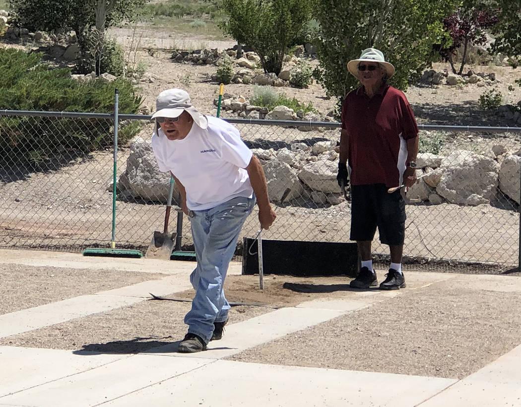 Tom Rysinski/Pahrump Valley Times Harold Holbrook of Carson City pitches as Ken Jose of Tonopah ...