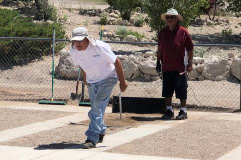 Tom Rysinski/Pahrump Valley Times Harold Holbrook of Carson City pitches as Ken Jose of Tonopah ...