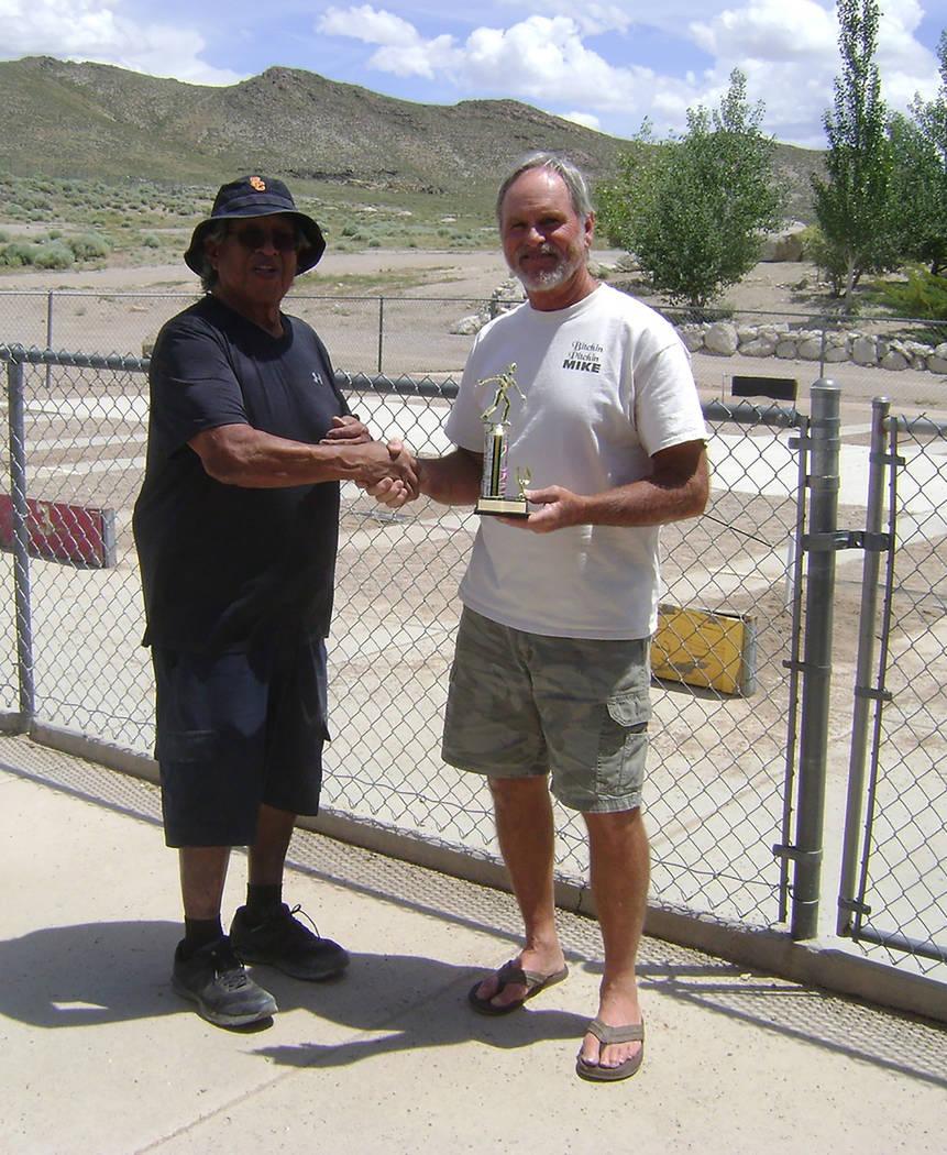 Mike Norton/Special to the Pahrump Valley Times Tournament host Ken Jose, left, congratulates B ...