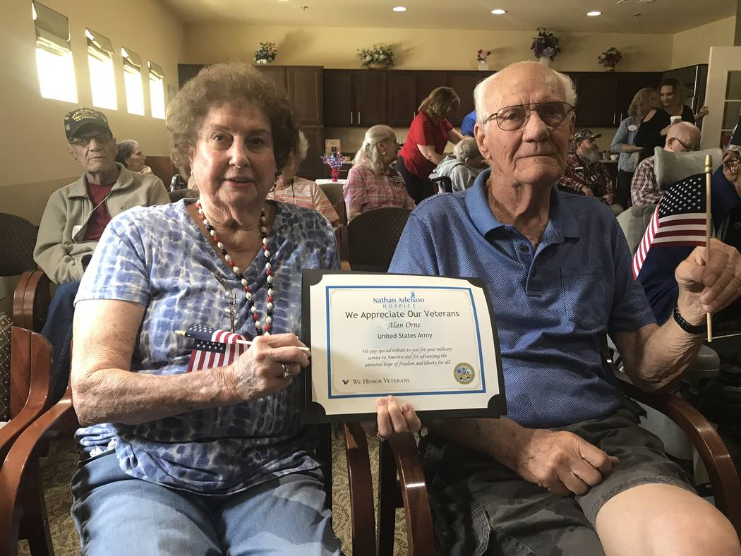 Jeffrey Meehan/Pahrump Valley Times Alan Orne (right), a veteran of the U.S. Army, sits with hi ...