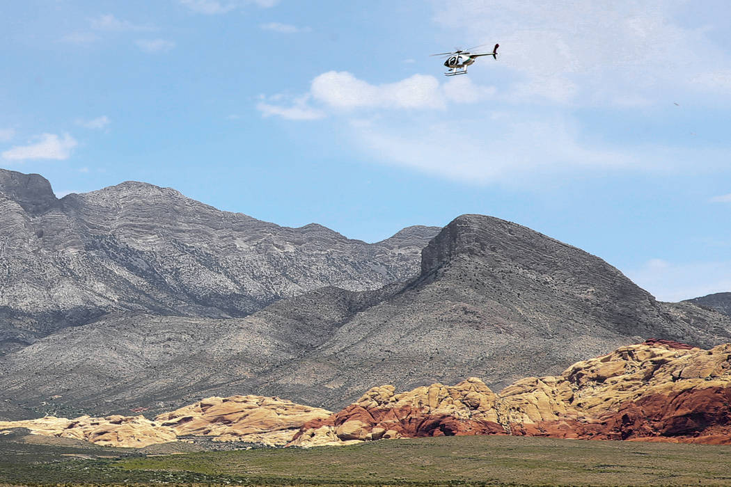 K.M. Cannon/Las Vegas Review-Journal A helicopter flies near the Red Rock Overlook on U.S. High ...