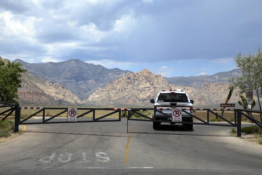 K.M. Cannon/Las Vegas Review-Journal A U.S. Bureau of Land Management ranger blocks the entranc ...