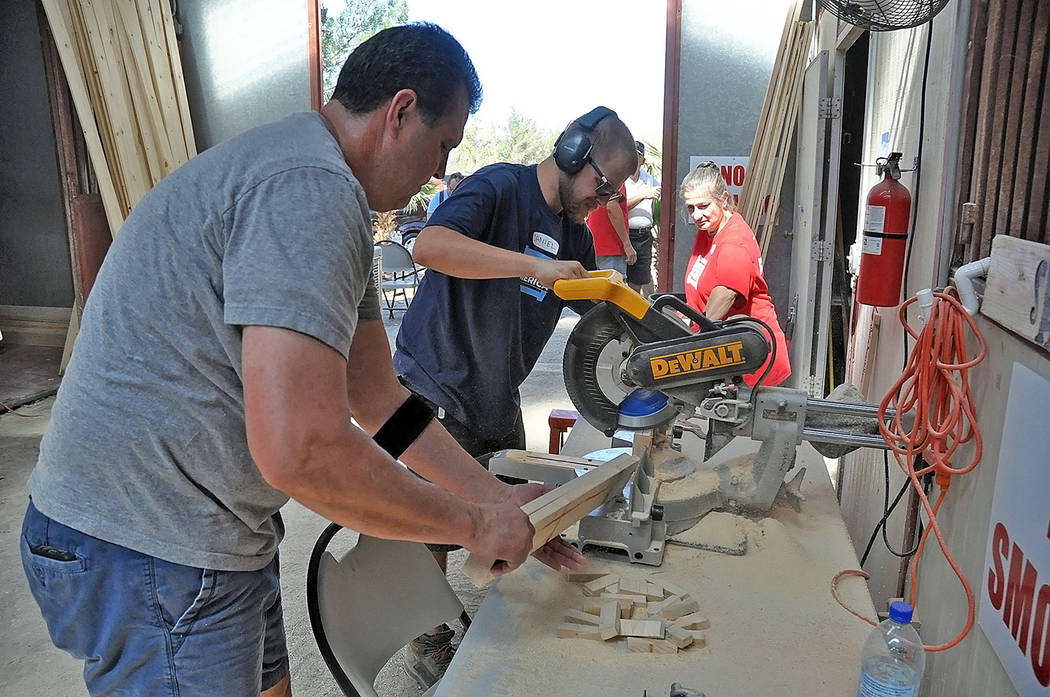 Horace Langford Jr./Pahrump Valley Times - The buzz of power tools filled the air as volunteers ...