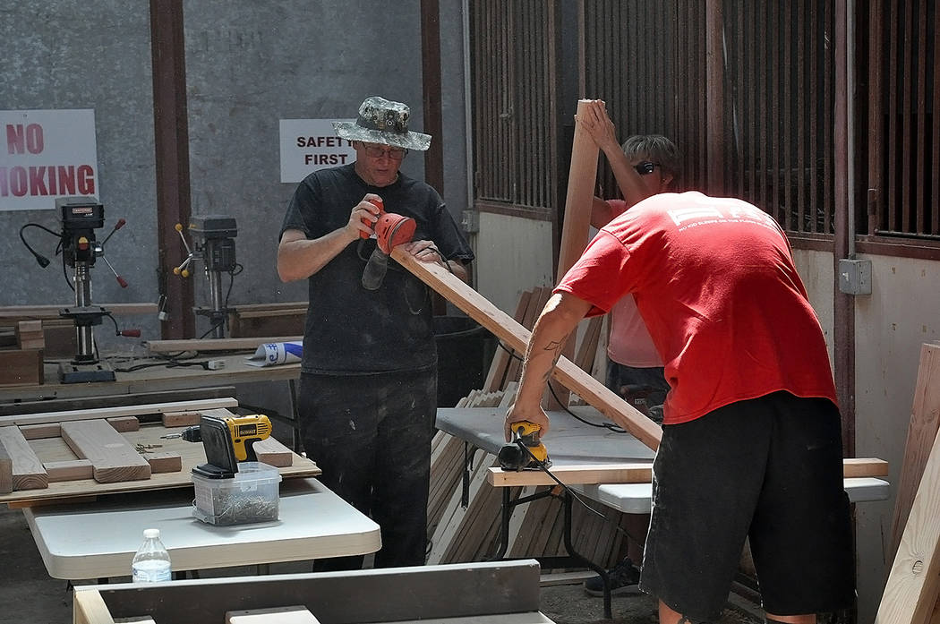 Horace Langford Jr./Pahrump Valley Times - Volunteers are pictured sanding lengths of board tha ...