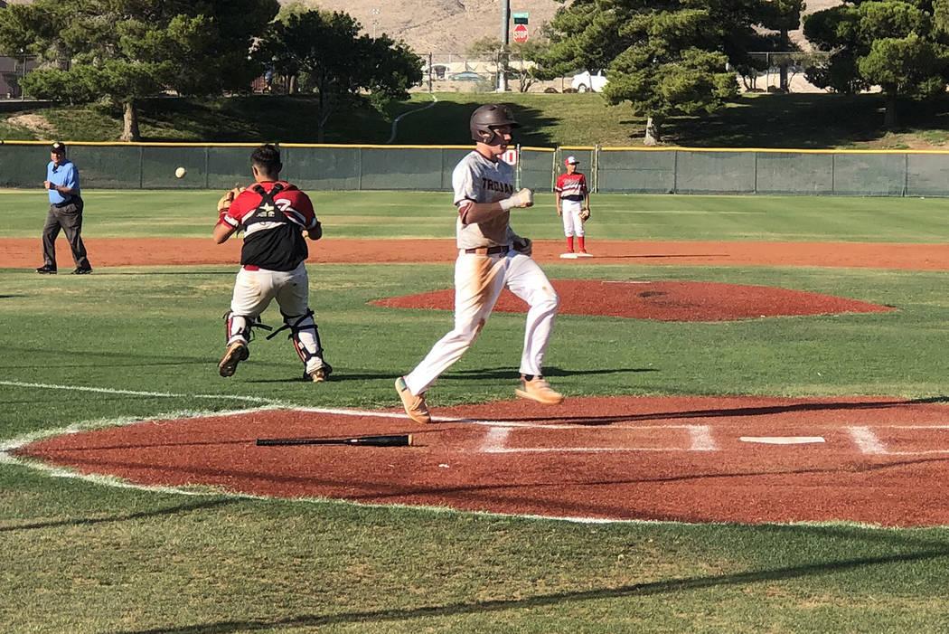 Tom Rysinski/Pahrump Valley Times Pahrump's Chase McDaniel scores on a sacrifice fly by Jake Ri ...