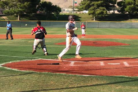 Tom Rysinski/Pahrump Valley Times Pahrump's Chase McDaniel scores on a sacrifice fly by Jake Ri ...