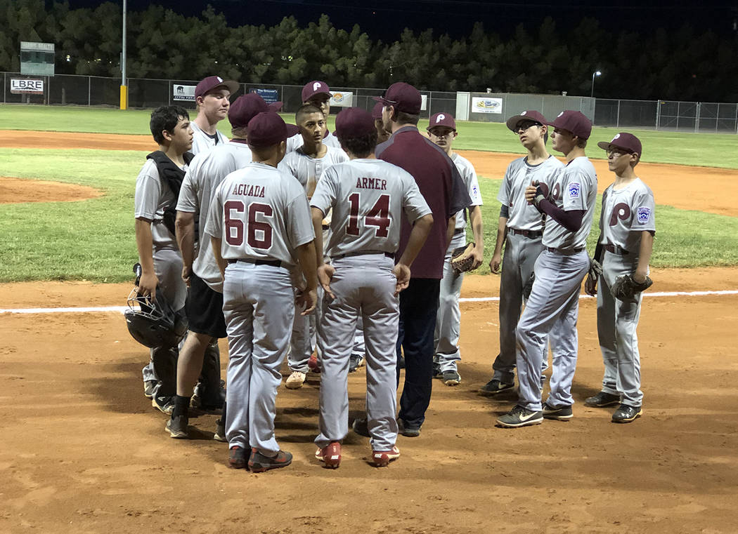 Tom Rysinski/Pahrump Valley Times Pahrump Little League's Junior All-Stars gather around coach ...