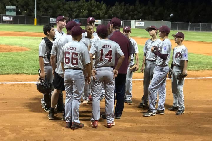 Tom Rysinski/Pahrump Valley Times Pahrump Little League's Junior All-Stars gather around coach ...