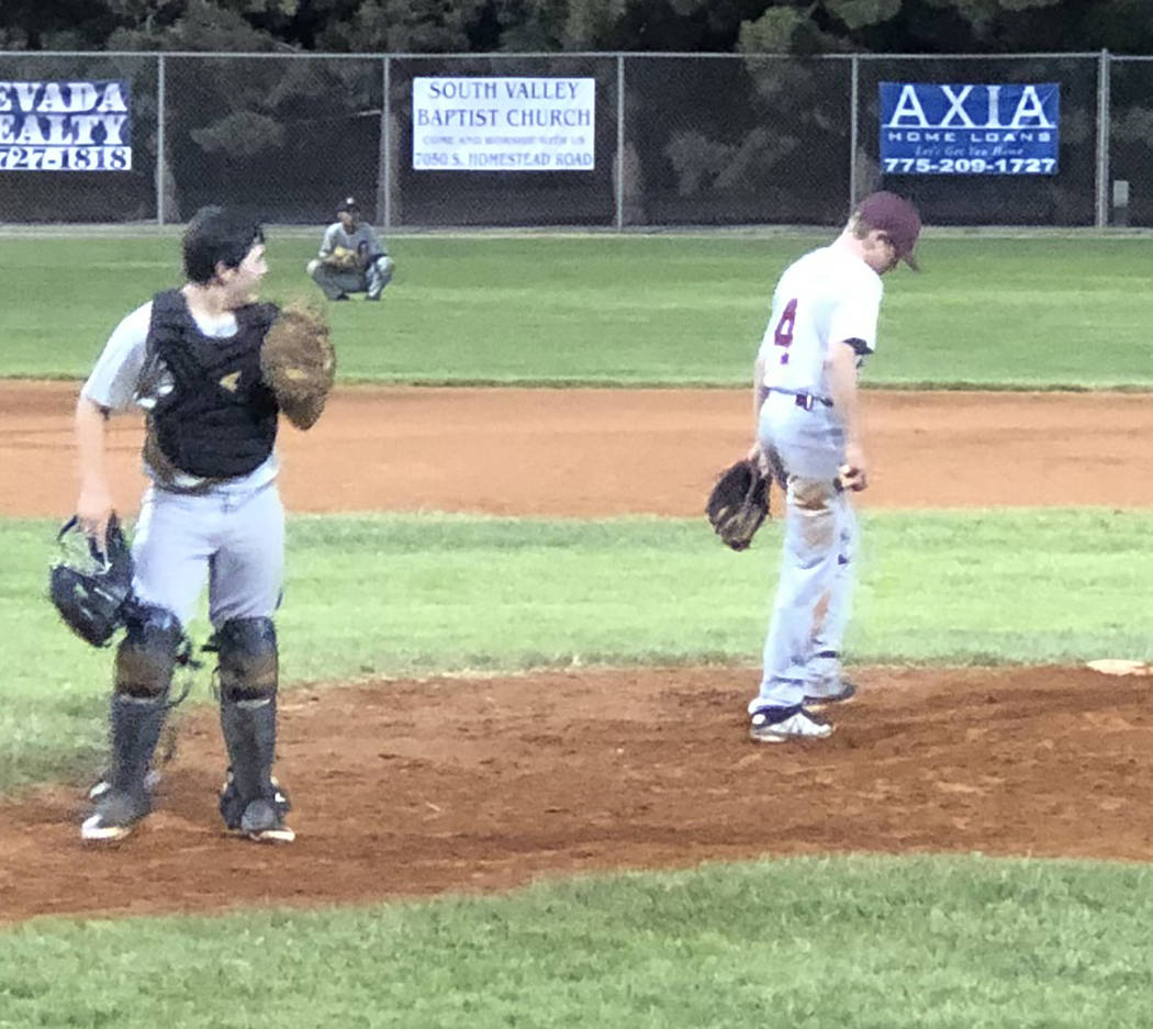 Tom Rysinski/Pahrump Valley Times Pahrump catcher Austin Sandoval heads back behind the plate a ...