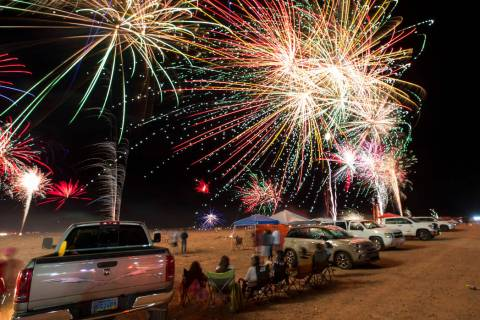 Fireworks explode from a launchpad behind the Moapa Paiute Travel Plaza firework store during F ...