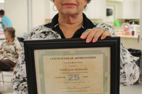 Robin Hebrock/Pahrump Valley Times Shadow Mountain Quilters Founder Lynn McDonald poses with he ...