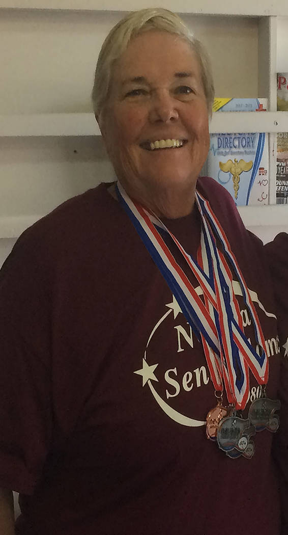 Special to the Pahrump Valley Times Susan Zink poses with some of the medals she has won at the ...
