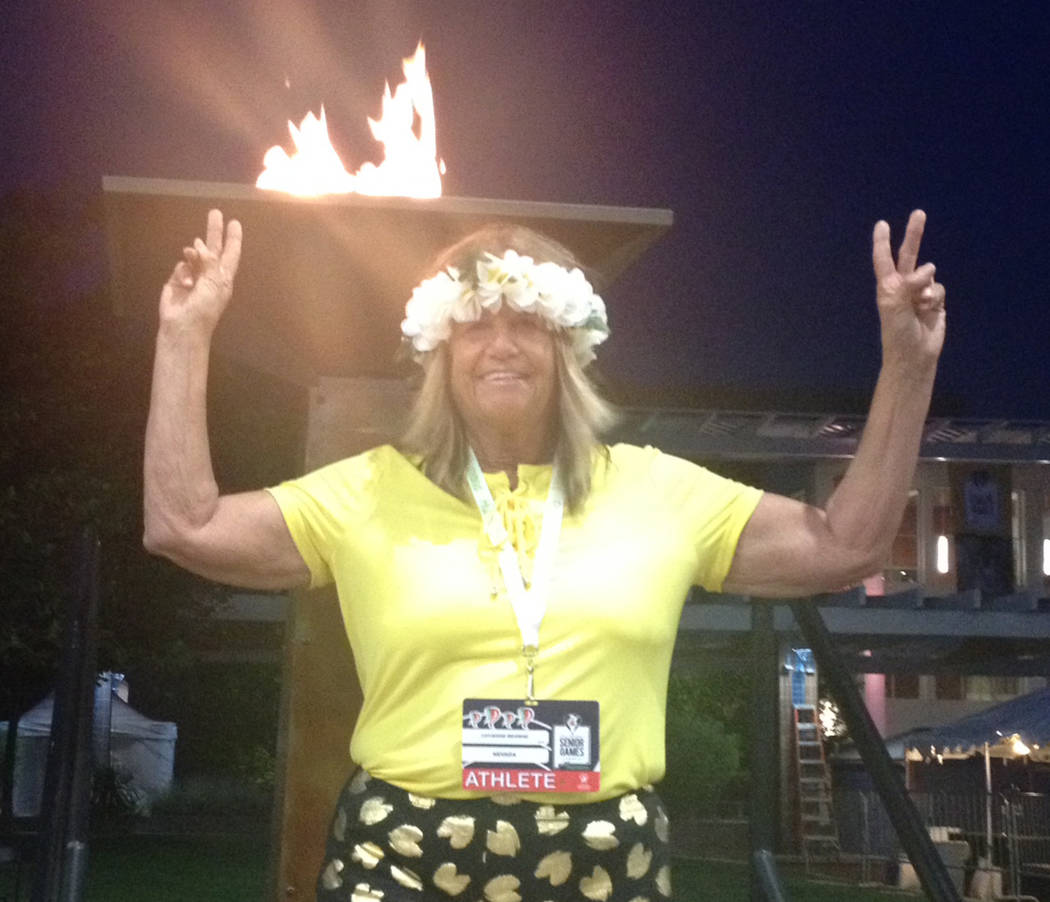 Special to the Pahrump Valley Times Pahrump resident Cathy Behrens in front of the torch that w ...