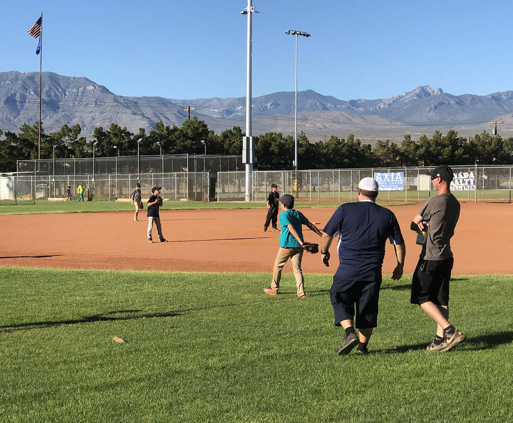 Tom Rysinski/Pahrump Valley Times Pahrump Little League coaches Richard Swingle, left, and Step ...