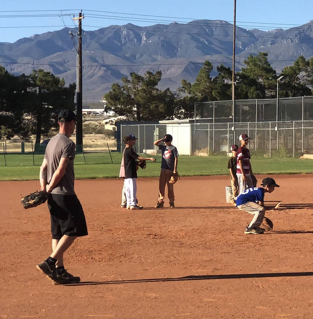 Tom Rysinski/Pahrump Valley Times Pahrump Little League all-stars practice fielding ground ball ...