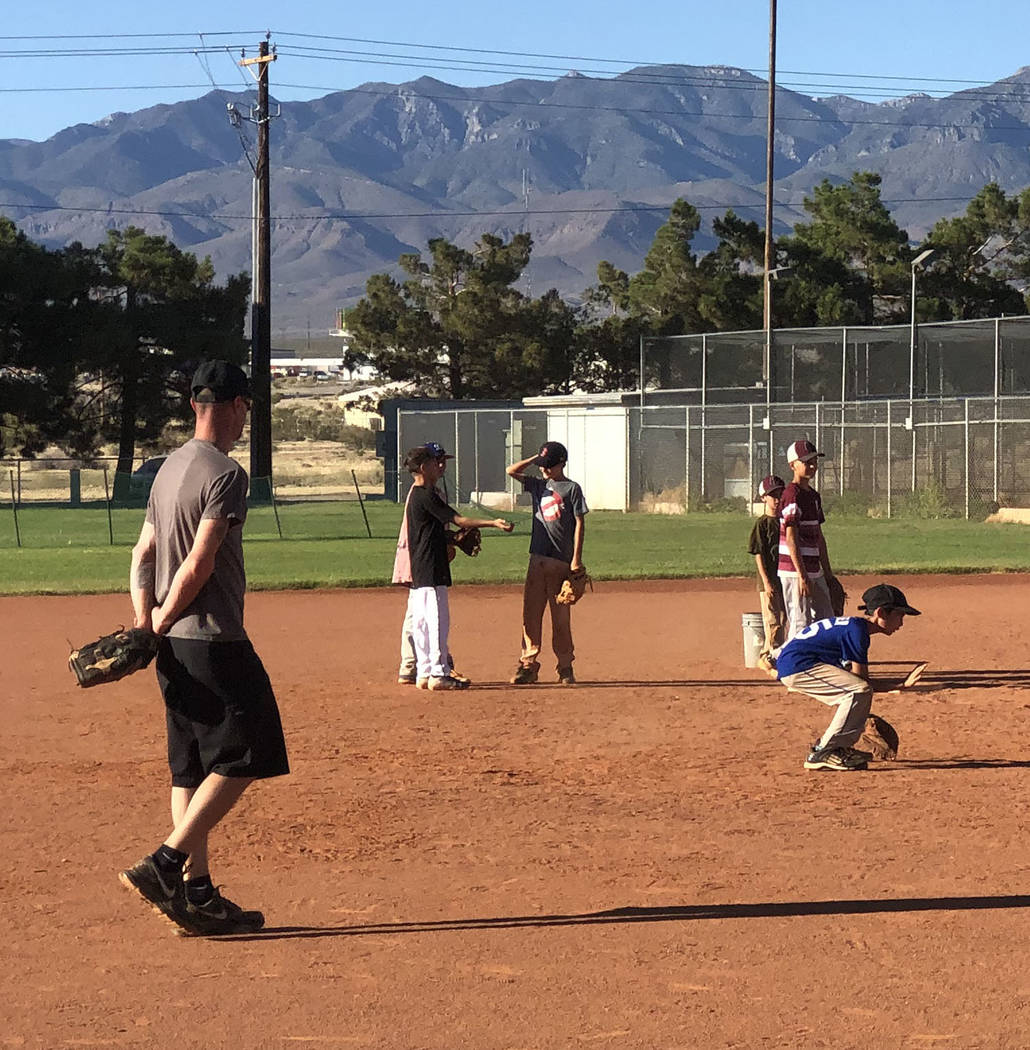 Tom Rysinski/Pahrump Valley Times Pahrump Little League all-stars practice fielding ground ball ...