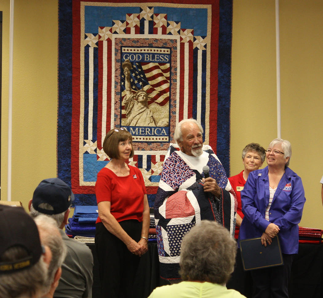 Robin Hebrock/Pahrump Valley Times Veteran Dennis Eggert, surrounded by smiling members of the ...
