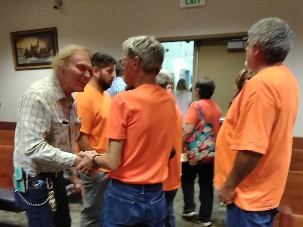 Selwyn Harris/Pahrump Valley Times Christina Weir's father Jim, (center), and clad in an orange ...