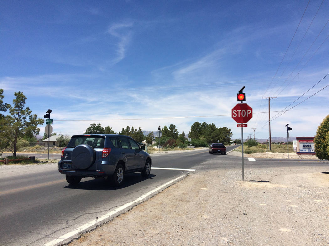 Robin Hebrock/Pahrump Valley Times New stops signs were also added to the intersection of Wilso ...