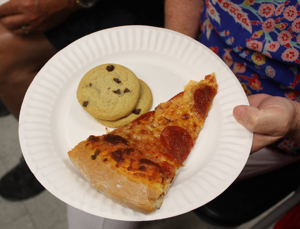 Robin Hebrock/Pahrump Valley Times Pizza and cookies helped keep hunger at bay during the town ...