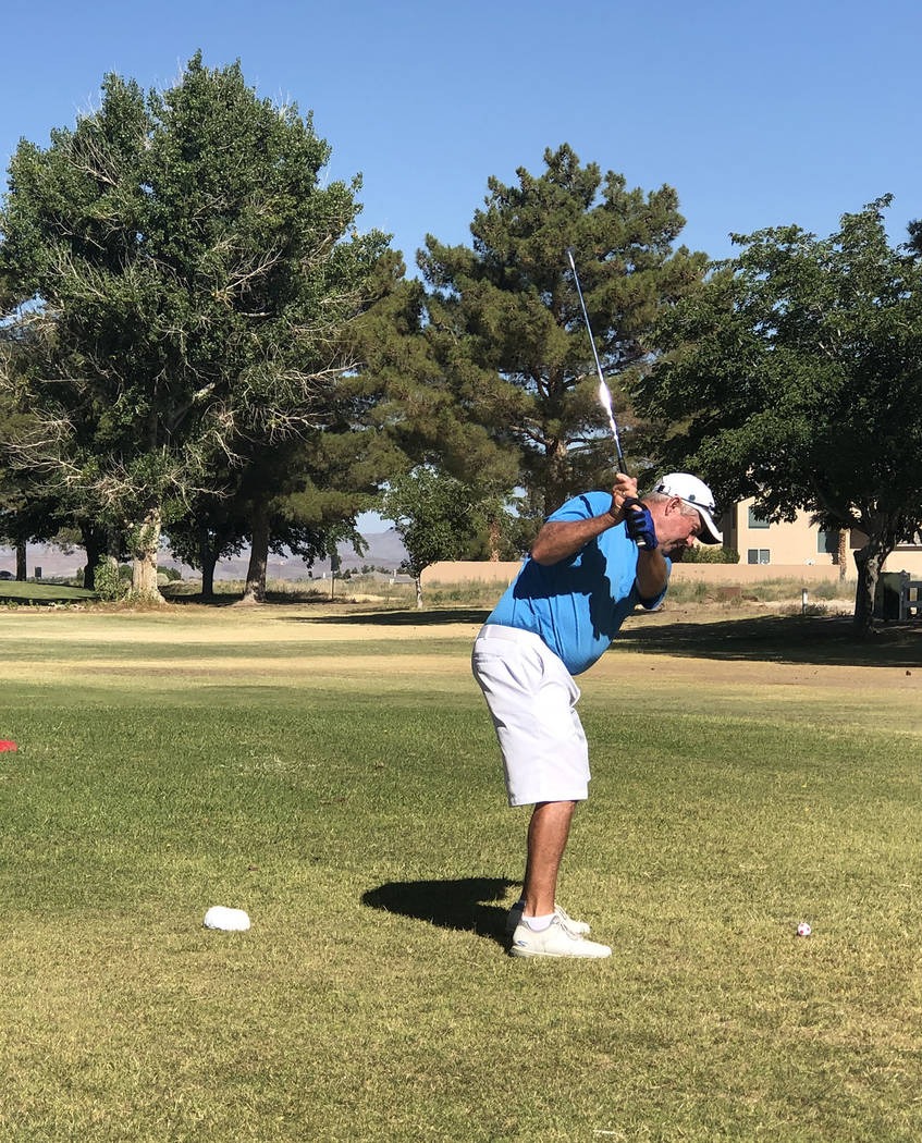 Tom Rysinski/Pahrump Valley Times Pahrump Valley High School golf coach Bob Hopkins tees off Sa ...