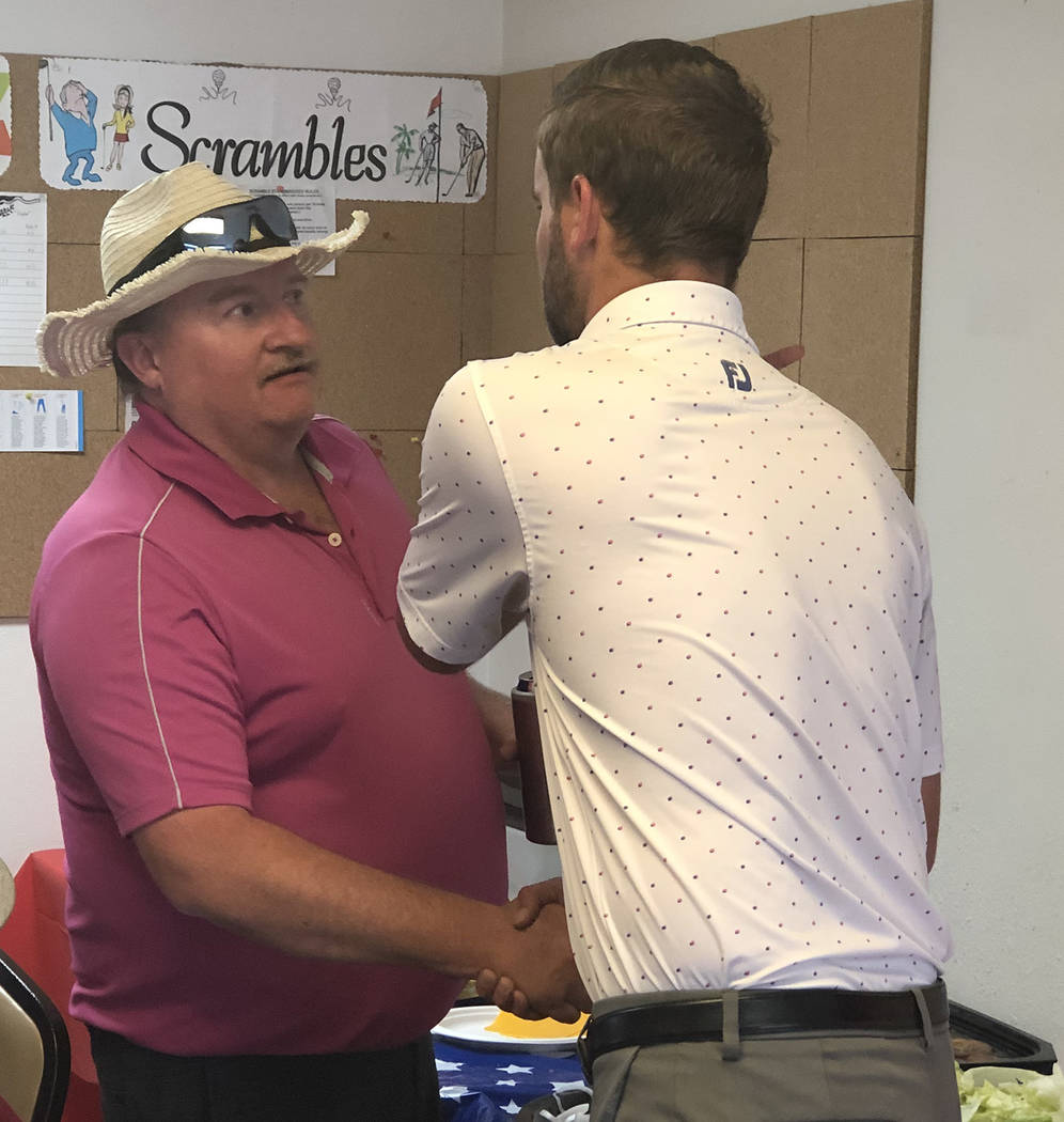 Tom Rysinski/Pahrump Valley Times Deron Jones, right, of Pahrump accepts congratulations from W ...