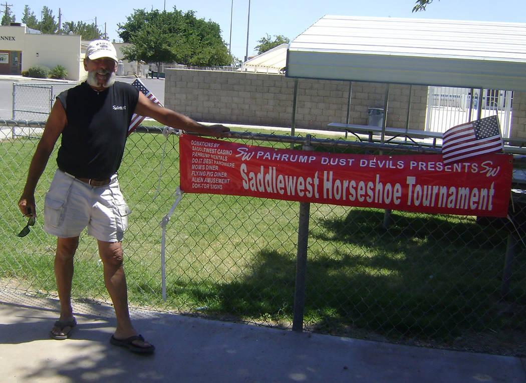 Mike Norton/Special to the Pahrump Valley Times Dok Hembree of Pahrump poses with the sign he m ...