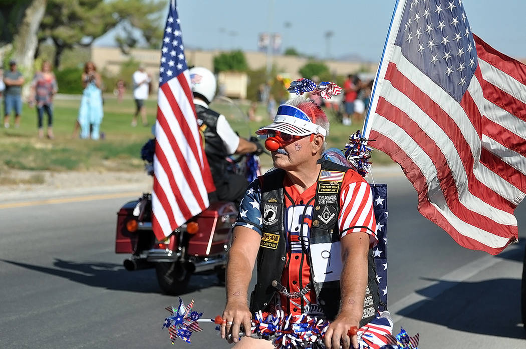 Horace Langford Jr./Pahrump Valley Times A parade entrant shows his patriotism as he rode his ...