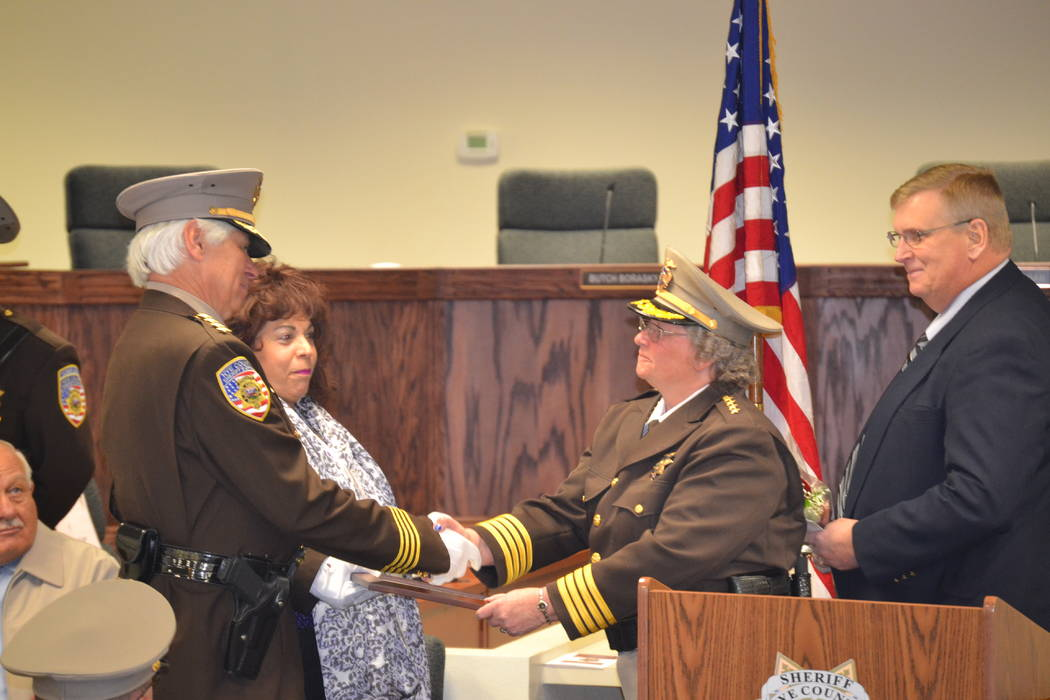 Lillian Browne/Pahrump Valley Times file This 2015 photo shows, Sheriff Sharon Wehrly shakes ha ...