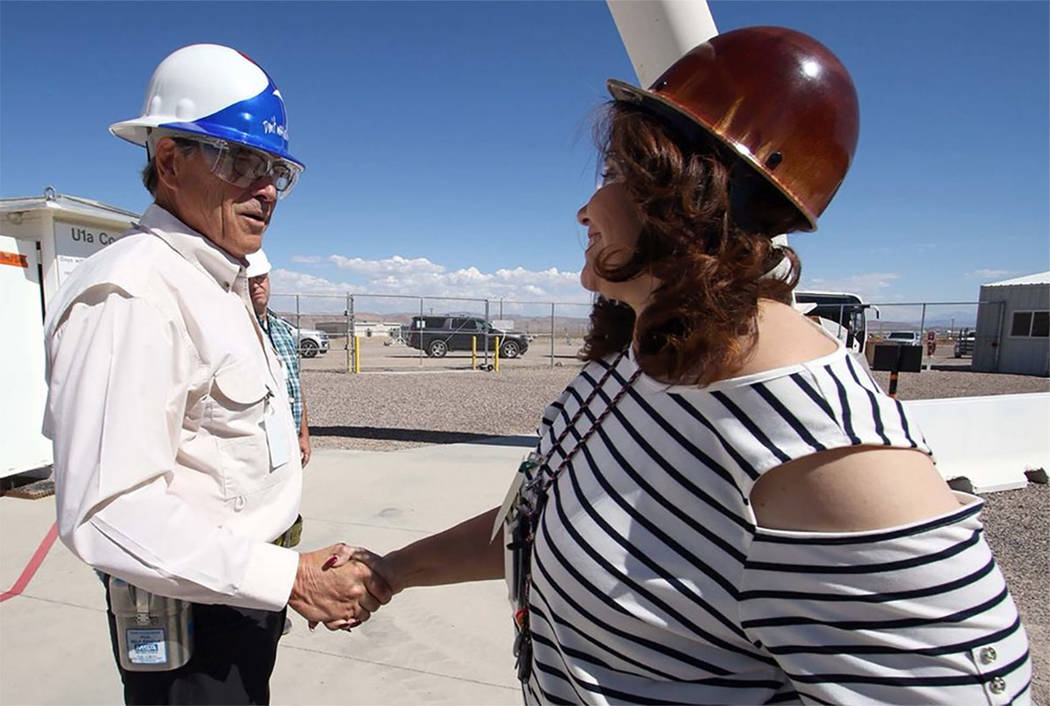 Photo/@SecretaryPerry on Twitter Energy Secretary Rick Perry greets a worker at the Nevada Nati ...