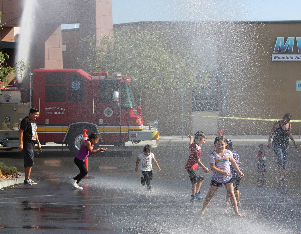 Robin Hebrock/Pahrump Valley Times Dancing in the shower of spray from the Pahrump Valley Fire ...