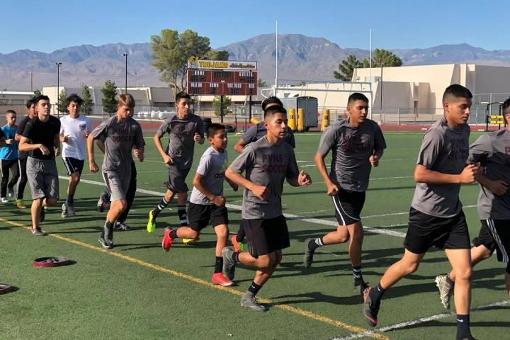 Tom Rysinski/Pahrump Valley Times Pahrump Valley High School boys soccer players run laps durin ...