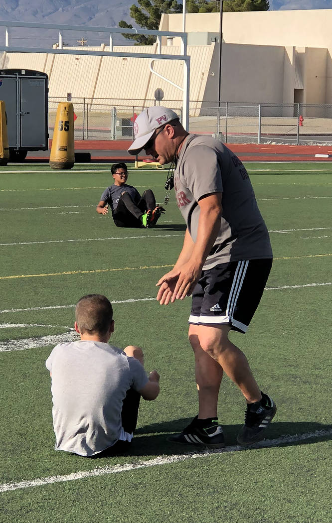 Tom Rysinski/Pahrump Valley Times Boys soccer coach Chris Roberts explains proper form to one o ...