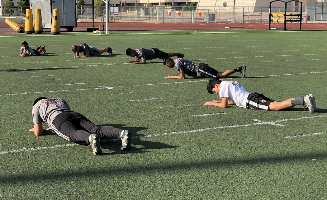 Tom Rysinski/Pahrump Valley Times Push-ups are part of the routine during conditioning drills f ...