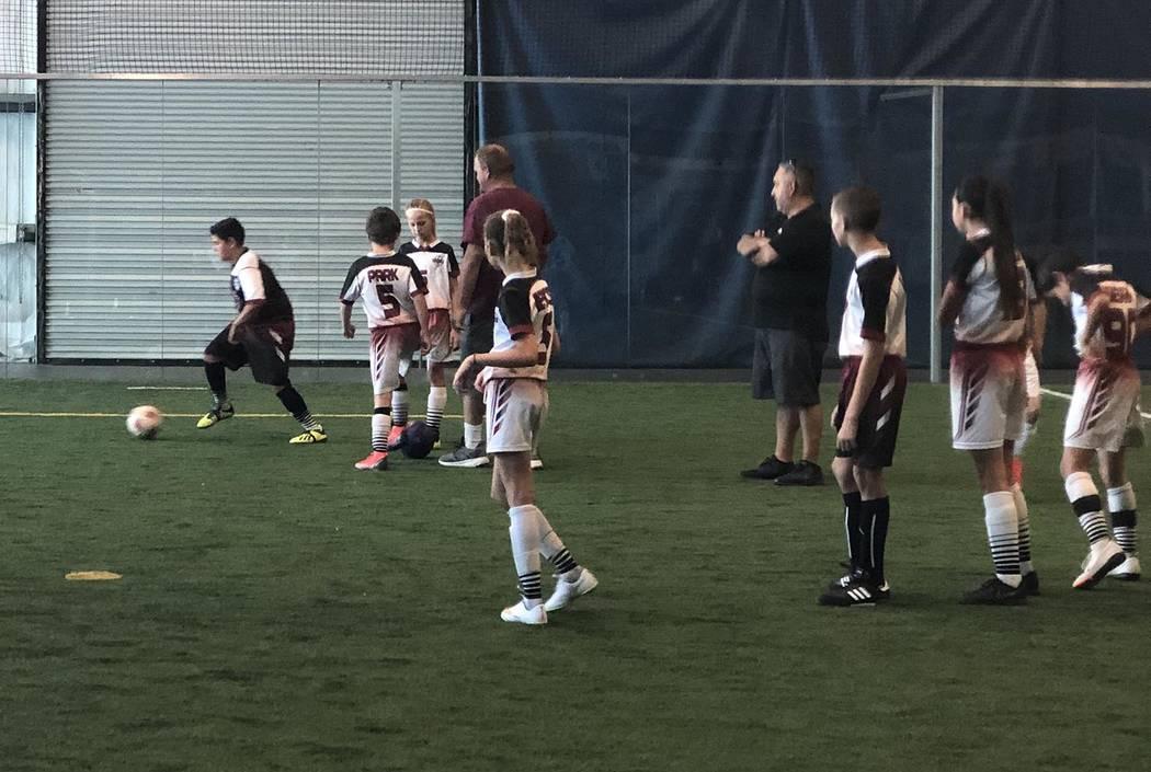 Tom Rysinski/Pahrump Valley Times Pahrump Junior Trojans White players warm up before their gam ...