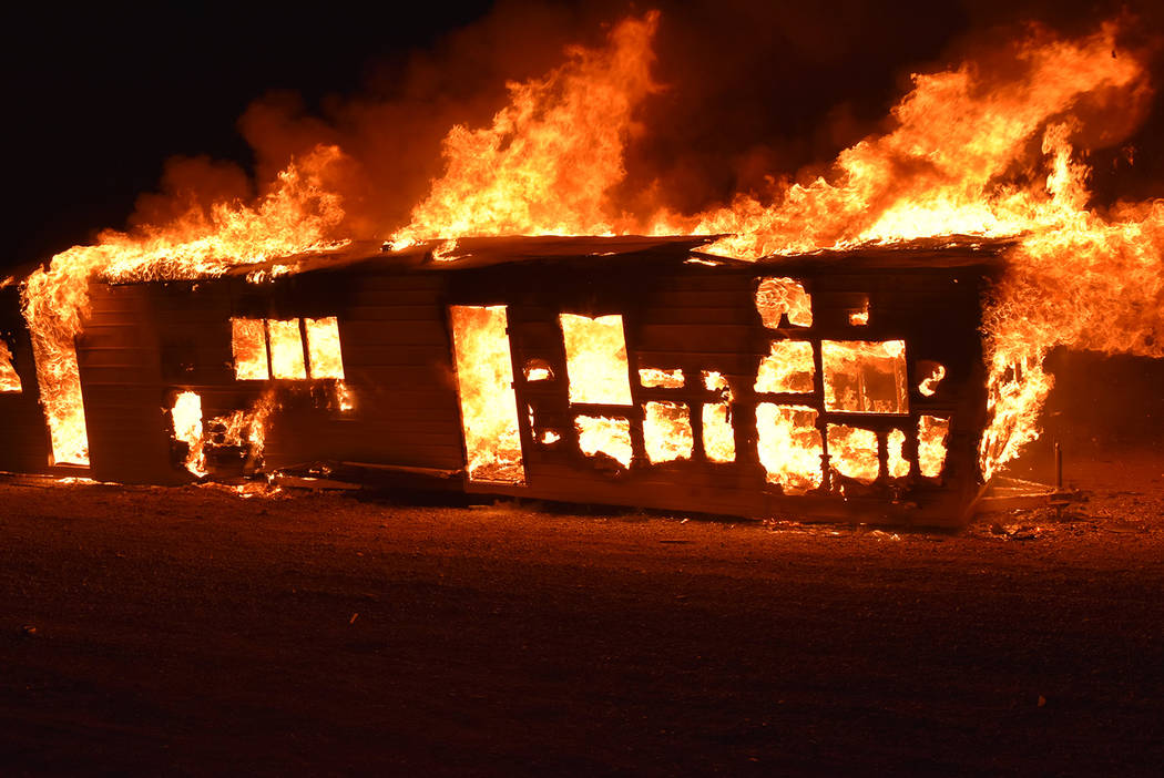 Special to the Pahrump Valley Times Fire destroyed a travel trailer in the area of Barney Stree ...
